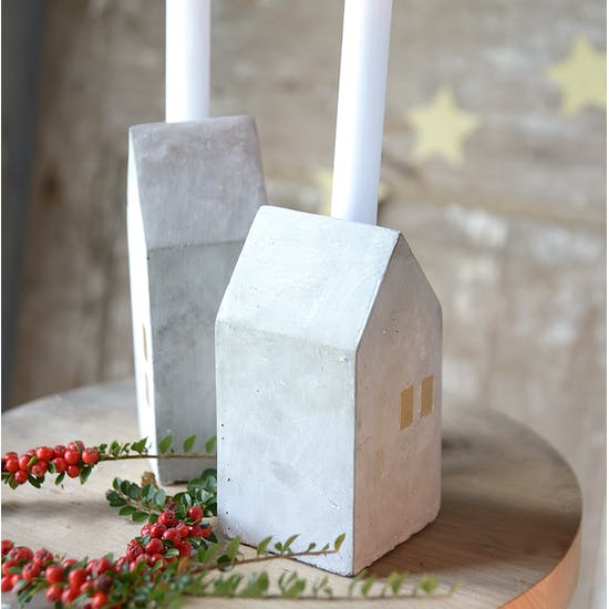 A Set Of Four Concrete House Candle Holders