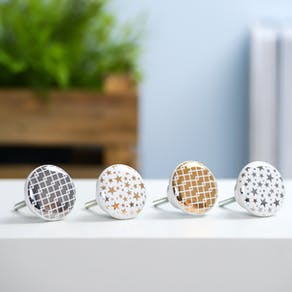 Gold and silver star knobs
