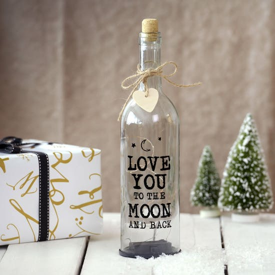 'Love You To The Moon And Back' is on the front of the bottle.