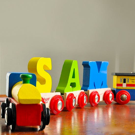 Coloured wooden name train spelling 'Sam'