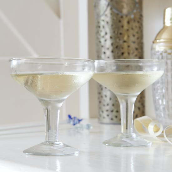 A Pair Of Champagne Coupes With Etched Stars