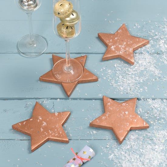 A Set Of Four Copper Star Coasters