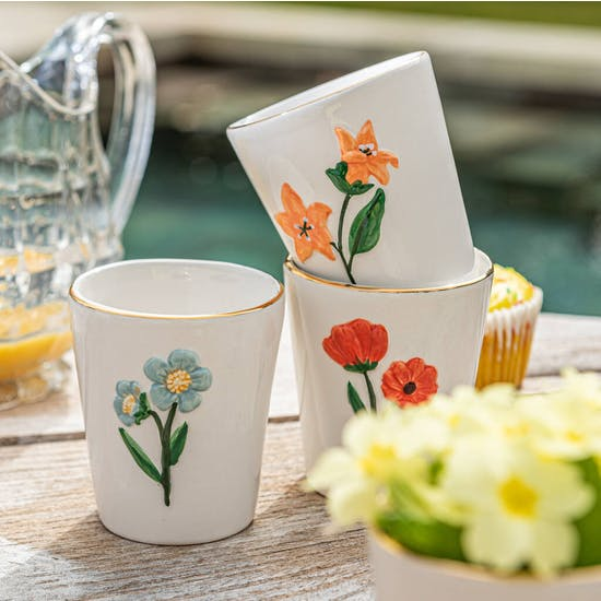 A set of Hand Painted Dolomite Flower Tumblers