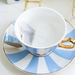 Striped China Teacup And Saucer
