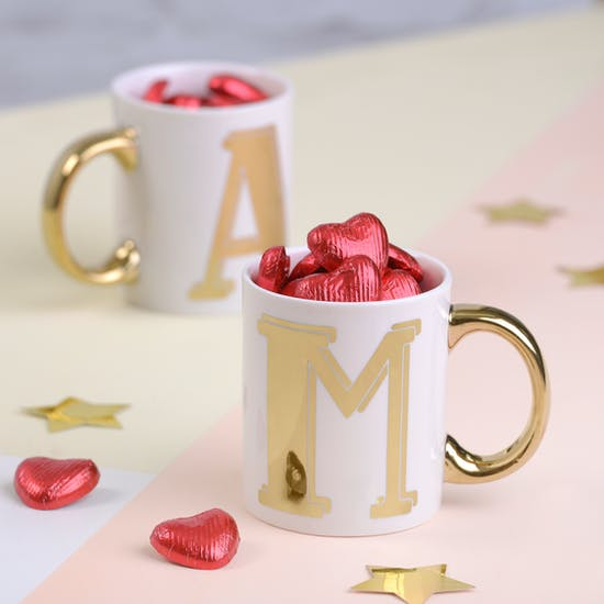 Gold Monogram Mug Filled With Heart Chocolate