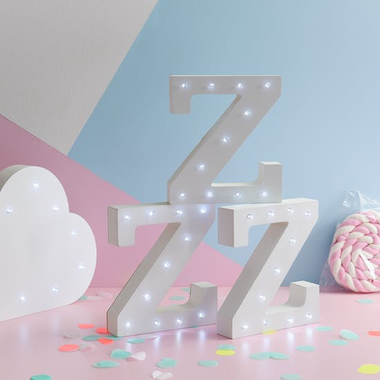 White light up letters displayed in a nursery saying 'ZZ'