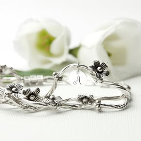 A Personalised Fine Silver 'Forget Me Knot' Bracelet